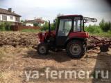 Услуги по вспашке земли мини трактором Московская область.